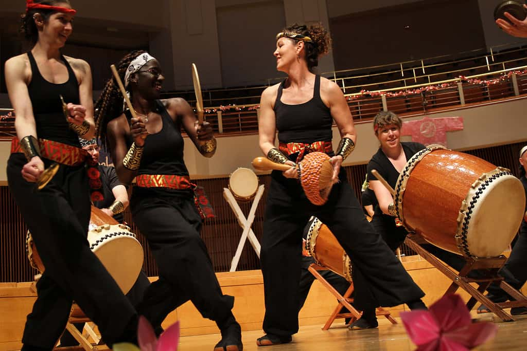 three taiko players at a performance